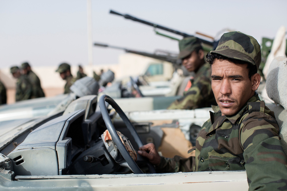 Western Sahara/Mijek 2015-01-14<br /> Mijek, a town in the liberated territories of Western Sahara, controlled by the Polisario Front. Abdalahi Brahim, 22 years old., has served in the army for four years. He was born in the refugee camps in Algeria, but is stationed in the third military region in Mijek,  &rdquo;I joined to serve my country and my people, I hope to go back to my homeland&rdquo;.