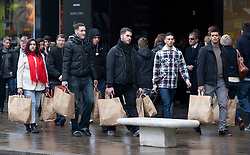 © licensed to London News Pictures. London, UK 13/02/2012. A group of shoppers walking with shopping bags on the day before Valentine's Day in Oxford Street, London. Photo credit: Tolga Akmen/LNP