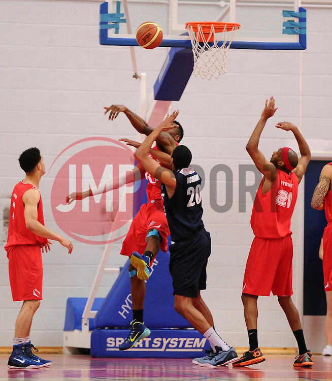 Bristol Flyers' Alif Bland blocks a shot towards the basket  - Photo mandatory by-line: Joe Meredith/JMP - Mobile: 07966 386802 - 11/04/2015 - SPORT - Basketball - Bristol - SGS Wise Campus - Bristol Flyers v Glasgow Rocks - British Basketball League