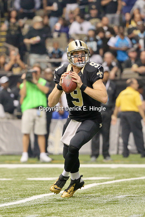 Dec 6, 2015; New Orleans, LA, USA; New Orleans Saints quarterback Drew Brees (9) against the Carolina Panthers during the first half of a game at Mercedes-Benz Superdome. Mandatory Credit: Derick E. Hingle-USA TODAY Sports