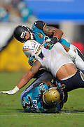 San Diego Chargers running back Ryan Mathews (24) is tackled by Jacksonville Jaguars free safety Josh Evans (26) and strong safety Johnathan Cyprien (37) during an NFL game against the Jacksonville Jaguars at EverBank Field on Oct. 20, 2013 in Jacksonville, Florida. San Diego won 24-6.<br /> <br /> &copy;2013 Scott A. Miller