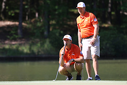 Clemson  head football coach Dabo Swinney and Former Clemson punter and current assistant football coach Bill Spiers during the Chick-fil-A Peach Bowl Challenge at the Ritz Carlton Reynolds, Lake Oconee, on Tuesday, April 30, 2019, in Greensboro, GA. (Chris Collins via Abell Images for Chick-fil-A Peach Bowl Challenge)