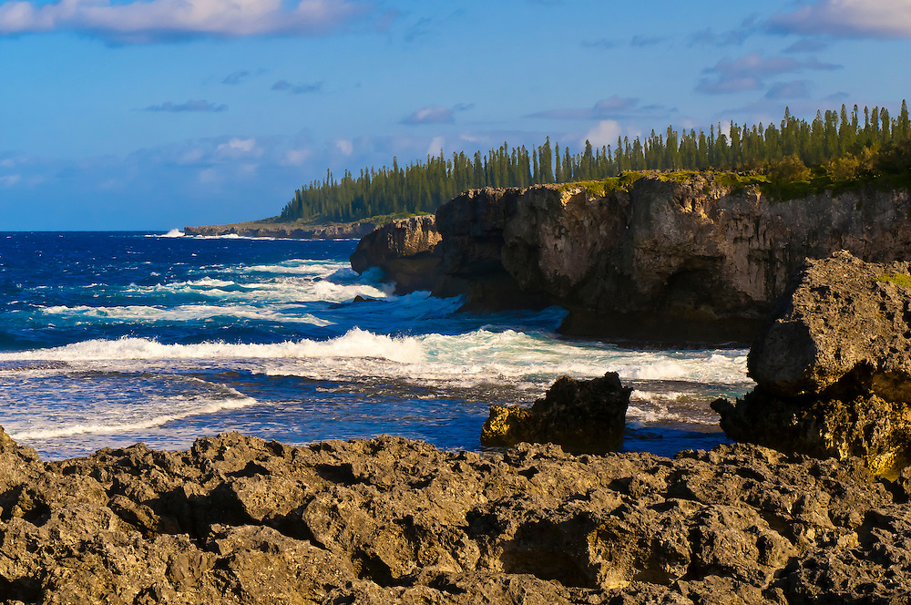 The rugged coastline of Ile des Pin (Isle of Pines), near the Natural Swimming Pool, Baie d'Oro (Oro Bay), New Caledonia