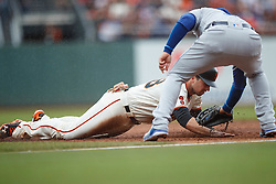 SAN FRANCISCO, CA - OCTOBER 02: Buster Posey #28 of the San Francisco Giants is picked off at first base on a tag by Adrian Gonzalez #23 of the Los Angeles Dodgers during the first inning at AT&T Park on October 2, 2016 in San Francisco, California.  (Photo by Jason O. Watson/Getty Images) *** Local Caption *** Buster Posey; Adrian Gonzalez