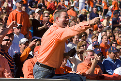 A UVA fan celebrates a first down during the Miami game.  The Virginia Cavaliers faced the Miami Hurricanes in a NCAA football game at Scott Stadium on the Grounds of the University of Virginia in Charlottesville, VA on November 1, 2008.Miami defeated Virginia 24-17 in overtime.