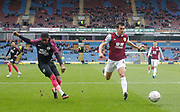 Reece Brown of Peterborough United(left) shoots on goal during the The FA Cup match between Burnley and Peterborough United at Turf Moor, Burnley, England on 4 January 2020.