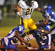 Water Valley's C.J. Jackson (26) makes a tackle vs. Charleston in Water Valley, Miss.  on Friday, September 16, 2011.