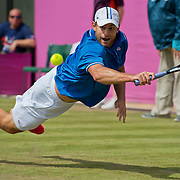 Andy Roddick of the United States dove for a backhand return against Martin Klizan of Slovakia during second round men's singles competition at Wimbledon during the 2012 Summer Olympic Games in London, England, Monday, July 30, 2012. (David Eulitt/Kansas City Star/MCT)