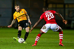 Scot Bennett of Newport County is marked by Akil Wright of Wrexham - Mandatory by-line: Ryan Hiscott/JMP - 11/12/2018 - FOOTBALL - Rodney Parade - Newport, Wales - Newport County v Wrexham - Emirates FA Cup second round proper