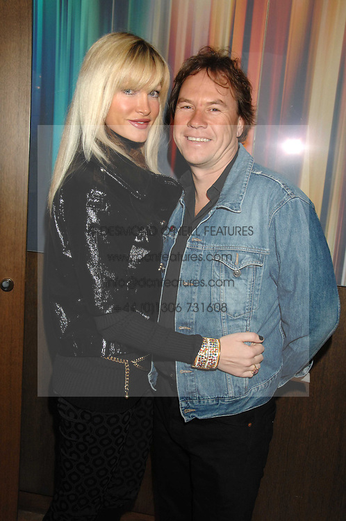 Model CAPRICE BOURRET and JOHN HITCHCOX at a party to celebrate the publication of Lisa B's book 'Lifestyle Essentials' held at the Cook Book Cafe, Intercontinental Hotel, Park Lane London on 10th April 2008.<br /><br />NON EXCLUSIVE - WORLD RIGHTS