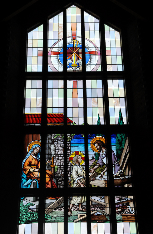 Stained glass image from St. William Church, Waukesha, shows a young Jesus with Joseph and Mary. (Photo by Sam Lucero)