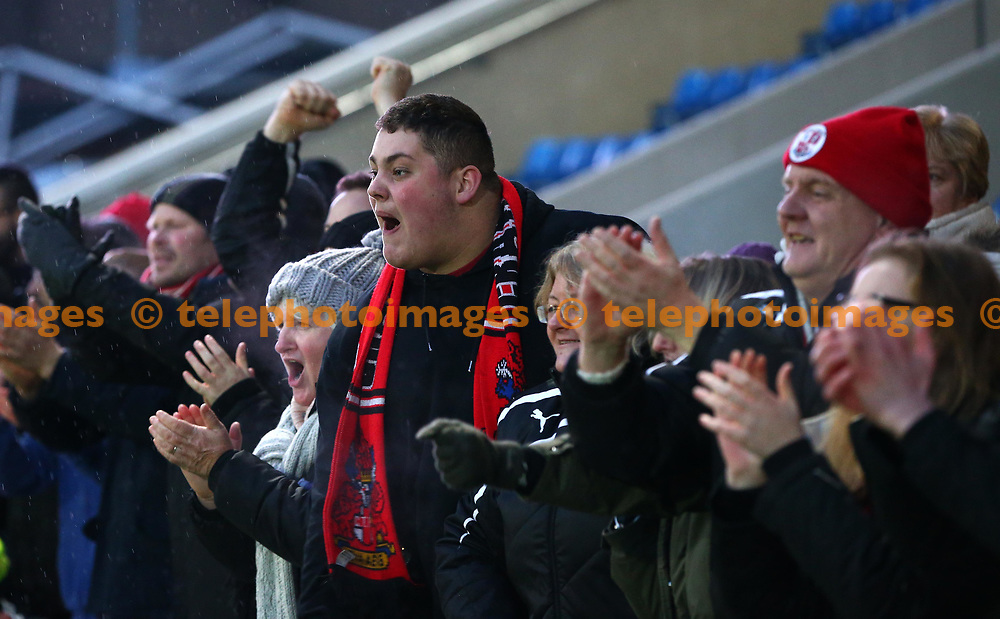 Crawley Town fans celebrate during the Sky Bet League 2 match between Chesterfield and Crawley Town at the Proact Stadium in Chesterfield. 03 Feb 2018