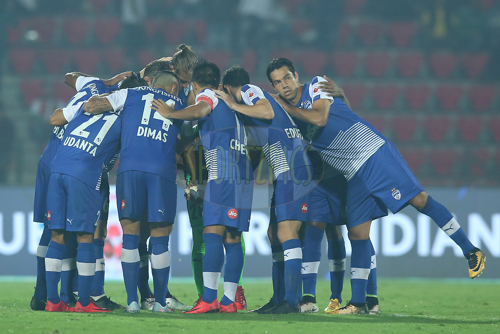 Bengaluru FC players make a hurdle during match 19 of the Hero Indian Super League between NorthEast United FC and Bengaluru FC held at the Indira Gandhi Athletic Stadium, Guwahati India on the 8th December 2017<br /> <br /> Photo by: Deepak Malik  / ISL / SPORTZPICS
