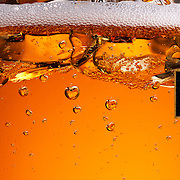 Bulmers Cider with bubbles in the shape of apples forming Ray Massey is an established, award winning, UK professional  photographer, shooting creative advertising and editorial images from his stunning studio in a converted church in Camden Town, London NW1. Ray Massey specialises in drinks and liquids, still life and hands, product, gymnastics, special effects (sfx) and location photography. He is particularly known for dynamic high speed action shots of pours, bubbles, splashes and explosions in beers, champagnes, sodas, cocktails and beverages of all descriptions, as well as perfumes, paint, ink, water – even ice! Ray Massey works throughout the world with advertising agencies, designers, design groups, PR companies and directly with clients. He regularly manages the entire creative process, including post-production composition, manipulation and retouching, working with his team of retouchers to produce final images ready for publication.