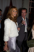 Elle Macpherson and Robert Hanson, The  Summer party, hosted by the Serpentine Gallery and Robert Cavalli, 16 June 2004. 16 June 2004. SUPPLIED FOR ONE-TIME USE ONLY> DO NOT ARCHIVE. © Copyright Photograph by Dafydd Jones 66 Stockwell Park Rd. London SW9 0DA Tel 020 7733 0108 www.dafjones.com