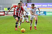 Kane Wilson (22) of Exeter City on the attack chased by Sean McConville (11) of Accrington Stanley during the EFL Sky Bet League 2 match between Exeter City and Accrington Stanley at St James' Park, Exeter, England on 25 November 2017. Photo by Graham Hunt.