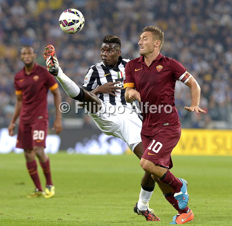 &copy; Filippo Alfero<br /> Juventus-Roma, Serie A 2014/2015<br /> Torino, 05/10/2014<br /> sport calcio<br /> Nella foto: Paul Pogba e Francesco Totti