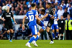 Victor Adeboyejo of Bristol Rovers is challenged by Leon Balogun of Brighton & Hove Albion - Rogan/JMP - 27/08/2019 - FOOTBALL - Memorial Stadium - Bristol, England - Bristol Rovers v Brighton & Hove Albion - Carabao Cup.