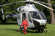 MD902 Explorer helicopter doctor crew from the Kent, Surrey & Sussex Air Ambulance Trust on the ground in Ruskin Park after emergency flight to Kings College Hospital in south London.