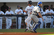Ole Miss' Alex Yarbrough (2) scores on a single by Ole Miss' Matt Snyder (33) at Oxford University Stadium in Oxford, Miss. on Tuesday, February 22, 2011.