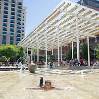 Mykel Love-Loman, 7, enjoys the pool and fountains at Director Park in Portland. 3:53pm
