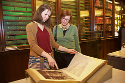 Non Jones (left, sp. correct) and Antonia Clark, development officers at the National Library of Scotland, view some of the images in a collection of 14,000 photos acquired by the library in a special collaboration with the National Galleries of Scotland, being shown to the public at the National Portrait Gallery, Edinburgh