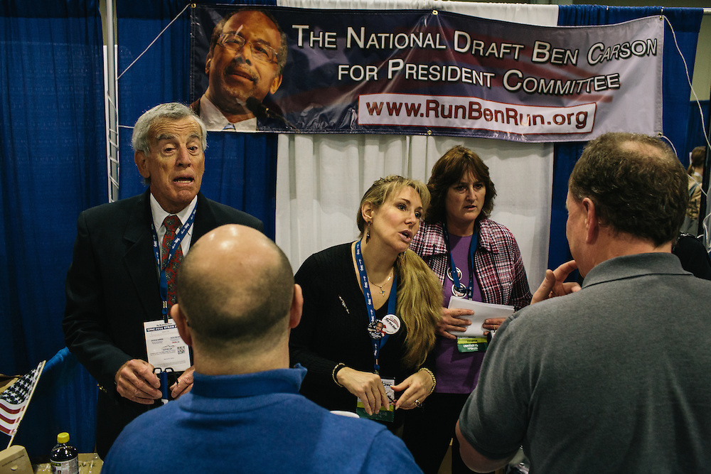 David Fischer, left, and other volunteers, talk to attendees at National Draft Ben Carson For President Committee booth during the final day of the Conservative Political Action Conference (CPAC) at the Gaylord National Resort & Convention Center in National Harbor, Md. Carson says he has no plans to run for President in 2016 and that he has no connection to those trying to get him to run.