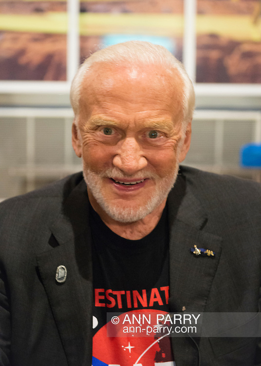 Garden City, New York, USA. October 23, 2015. Former NASA astronaut Edwin BUZZ ALDRIN discusses his experiences and signs copies of his new Children's  Middle Grade book Welcome to Mars: Making a Home on the Red Planet, at Long Island's Cradle of Aviation Museum.  Aldrin is wearing his Destination MARS shirt. On the 1969 Apollo 11 mission, Buzz Aldrin was the second person ever to walk on the Moon, and his first trip to space was the 1966 Gemini 12.
