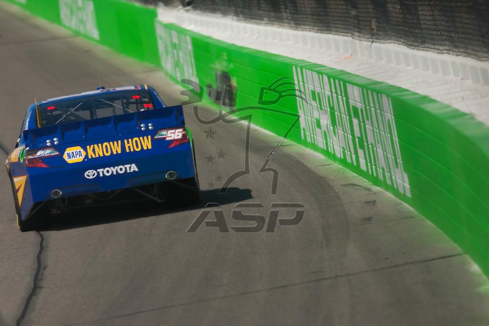 KANSAS CITY, KS - APR 20, 2012:  Martin Truex, Jr. (56) brings his car through the turns during a practice session for the STP 400 at the Kansas Speedway in Kansas City, KS.