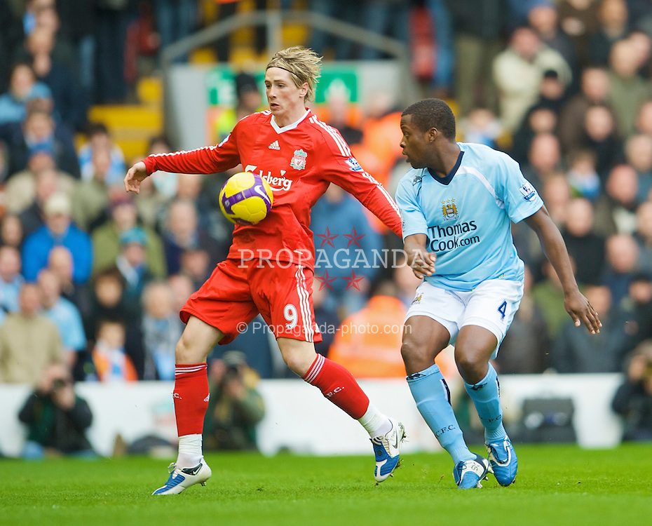 LIVERPOOL, ENGLAND - Sunday, February 22, 2009: Liverpool's Fernando Torres and Manchester City's Nedum Onuoha during the Premiership match at Anfield. (Mandatory credit: David Rawcliffe/Propaganda)