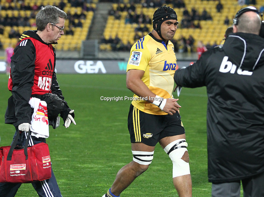 Hurricanes' Victor Vito leaves the field injured during the Round 17 Super Rugby match, between the Hurricanes & Crusaders. Westpac Stadium, Wellington. 28 June 2014. Photo.: Grant Down / www.photosport.co.nz