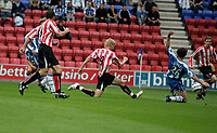 Photo: Peter Phillips.<br /> Wigan Athletic v Sunderland. The Barclays Premiership.<br /> 27/08/2005.<br /> Jon Stead has a go at goal only to see his effort pushed wide by keeper Pollitt