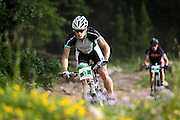 SHOT 8/19/11 8:56:30 AM - Chris Baddick of Boulder, Co. descends a rocky section of trail during the final day of racing in The Breck Epic in Breckenridge, Co.Baddick finished 10th in the Solo Open Men's category with an overall time of 19:57:26. The event is a 6-day ultra-endurance mountain bike stage race held in the sprawling backcountry surrounding the town of Breckenridge, Co. The course is 240 miles and features a combined 38,000 feet of climbing, 90% of which is above 10,000 feet. More than 200 riders from 15 different countries participated in the race. (Photo by Marc Piscotty / © 2011)