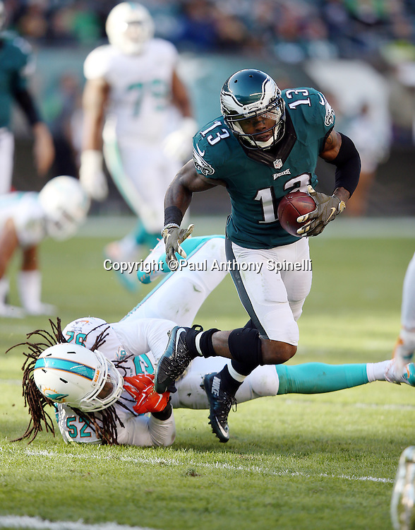 Philadelphia Eagles wide receiver Josh Huff (13) gets tackled by Miami Dolphins middle linebacker Kelvin Sheppard (52) after catching a pass for a gain of 5 yards and a first down at the Dolphins 44 yard line during the 2015 week 10 regular season NFL football game against the Miami Dolphins on Sunday, Nov. 15, 2015 in Philadelphia. The Dolphins won the game 20-19. (©Paul Anthony Spinelli)