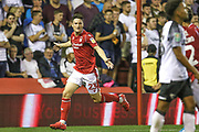 Joe Lolley (23) scores a goal and celebrates during the EFL Cup match between Nottingham Forest and Derby County at the City Ground, Nottingham, England on 27 August 2019.
