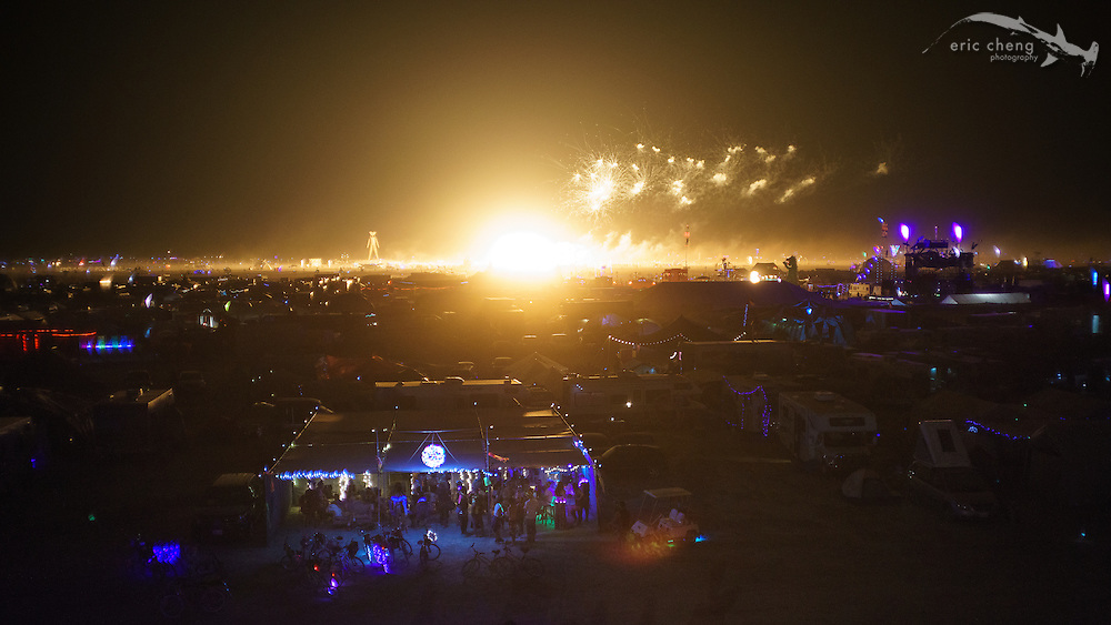 "Vines Without Boders camp with huge ""atomic bomb"" mushroom cloud burn in the background. Burning Man 2014."