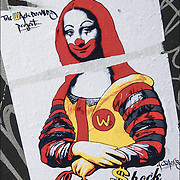 Public Space Art  or Street Art work on side of graffiti brown mail box. Is it  art or graffiti?<br />