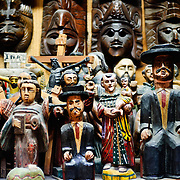 Wooden figurines of St Simon and other characters for sale in a market in Antigua Guatemala. Famous for its well-preserved Spanish baroque architecture as well as a number of ruins from earthquakes, Antigua Guatemala is a UNESCO World Heritage Site and former capital of Guatemala.