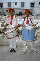 Two boys in band uniform each holding a drum,