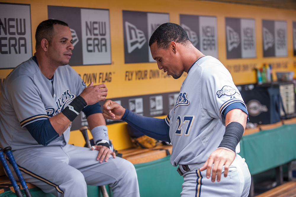 PITTSBURGH, PA - JUNE 08: Carlos Gomez #27  of the Milwaukee Brewers slaps hands with Aramis Ramirez #16  in the dugout during the game against the Pittsburgh Pirates  at PNC Park on June 8, 2014 in Pittsburgh, Pennsylvania. (Photo by Rob Tringali) *** Local Caption *** Carlos Gomez;Aramis Ramirez