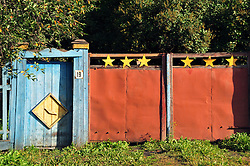 "A colorful gate along a back road near the Alekseevski Monastery in Uglich, Russia. One of Russia's ""Golden Ring"" cities, Uglich is one of the country's most culturally significant towns."