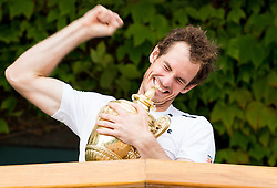 LONDON, ENGLAND - Sunday, July 10, 2016:  An ecstatic Andy Murray (GBR) holds  the Gentlemen's Singles Trophy on the balcony following his victory in the Gentlemen's Singles Final match against Milos Raonic (CAN) on day fourteen of the Wimbledon Lawn Tennis Championships at the All England Lawn Tennis and Croquet Club. (Pic by Kirsten Holst/Propaganda)