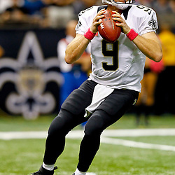 October 7, 2012; New Orleans, LA, USA; New Orleans Saints quarterback Drew Brees (9) looks to pass against the San Diego Chargers during the third quarter of a game at the Mercedes-Benz Superdome. The Saints defeated the Chargers 31-24. Mandatory Credit: Derick E. Hingle-US PRESSWIRE