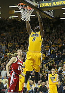 January 19 2013: Iowa Hawkeyes center Gabriel Olaseni (0) dunks the ball during the first half of the NCAA basketball game between the Wisconsin Badgers and the Iowa Hawkeyes at Carver-Hawkeye Arena in Iowa City, Iowa on Sautrday January 19 2013. Iowa defeated Wisconsin 70-66.