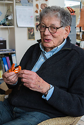 Retired product designer turned toy maker, whose many innovations became iconic household names Tom Karen is photographed with toys he created from recycled materials at his home in Cambridge, UK.<br /> PICTURED: Tom handles a miniature Bond Buggy, one of the many designs for which he is responsible. <br /> Cambridge, March 01 2018.
