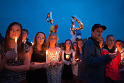 People attend the vigil for slain German exchange student, Diren Dede, on May 2, 2014, at the Fort Missoula soccer field where Dede had played.