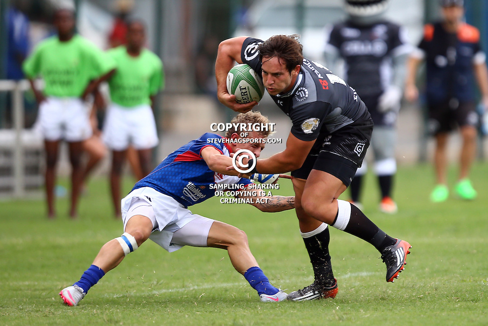 DURBAN, SOUTH AFRICA - APRIL 23: Riaan van Zyl of the Windhoek Draught Welwitschias looks to tackle Neil Maritz of the Cell C Sharks XV during the Provincial Cup match between Cell C Sharks XV and Windhoek Draught Welwitschias at King Zwelithini Stadium on April 23, 2016 in Durban, South Africa. (Photo by Steve Haag/Gallo Images)