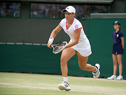 LONDON, ENGLAND - Sunday, July 3, 2011: Ashleigh Barty (AUS) in action during the Girls' Singles Final match on day thirteen of the Wimbledon Lawn Tennis Championships at the All England Lawn Tennis and Croquet Club. (Pic by David Rawcliffe/Propaganda)