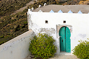 Portuguese Rampart Architecture, Asilah, Northern Morocco, 2015-08-10.<br /><br />Asilah is a sleepy fishing town in the North of Morocco, just one hour south of Tangier. While not completely off Morocco's well-beaten path, it's often missed by travellers bound inland for Fez or Chefchaouen, yet has a uniquely alluring charm. With an immaculately restored medina that's re-painted vivid shades of blue & white each summer, Asilah has the feel of being Morocco's own Santorini - a great spot to see the more chilled out, seaside town life in Morocco.  <br /><br />The town lies in the middle of a fascinating history in historical, architectural and artistic terms. It's 3,600 year old history that includes a varied range of occupiers, involving Roman, Arab Portuguese, Spanish and French colonisation. Many famous writers and artists have spent time here; in ancient times is it reported Herecules did a tour of the area and, more recently; Paul Bowles, Tennessee Williams, Edith Wharton, Jean Genet (who is buried in the nearby town of Larache), William Burroughs, Jimi Hendrix and Henri Matisse have all found the area inspiring. The Portuguese ramparts remain fully intact and a full day can be spent wandering through its old gates and the ever narrowing medina streets inside the walls.<br /><br />The architecture in Asilah has been heavily influenced by these different periods of occupation, which is one of the main reasons for its unique and characterful feel. Evidence of Mediterranean design can be seen in the rampart walls and gates themselves, reflecting the Spanish & Portuguese influence on the Asilah's development, Roman ruins can be found in the nearby town of Larache and Arab influences are more subtly found in the decorative window shutters and the labyrinth like medina layout to the streets. <br /><br />If a lover of the quirkier details found in the medinas of Morocco, then Asilah won't disappoint, with hundreds of creatively designed doorways, decorative window shut