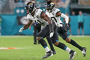 Aug 22, 2019; Miami Gardens, FL USA;  Jacksonville Jaguars defensive end Josh Allen (41) cornerback Jalen Ramsey (20) in sync during an NFL preseason game at Hard Rock Stadium. The Dolphins beat the Jaguars 22-7. (Kim Hukari/Image of Sport)